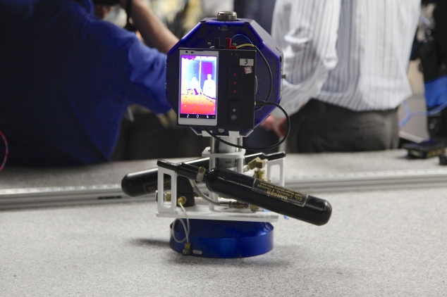 A NASA SPHERES robot equipped with a Google Project Tango phone displays a heat map of the people it sees. Photo by Signe Brewster.